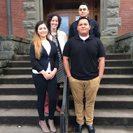 Dr. Hoover and her 3 research assistants standing on an outside staircase