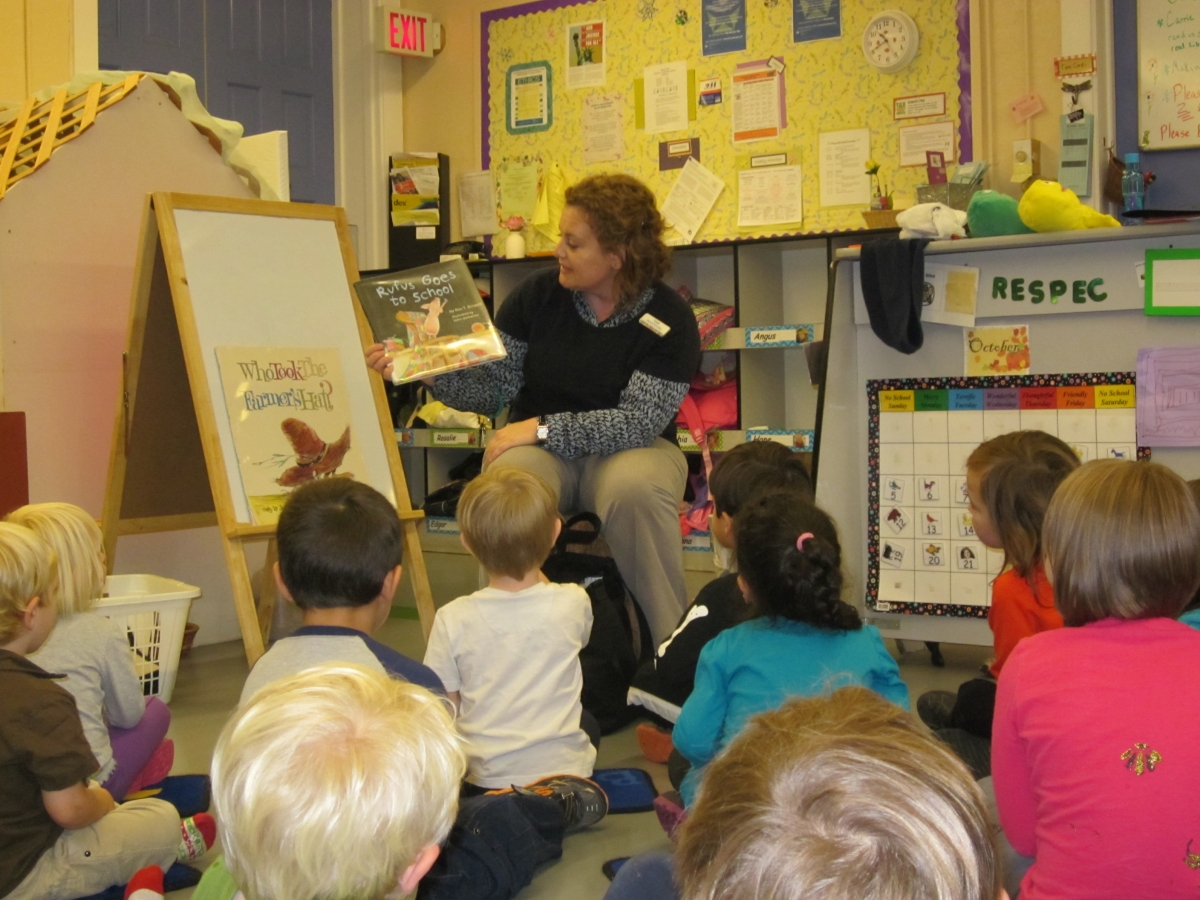 Teacher reading a book to her kindergarten class