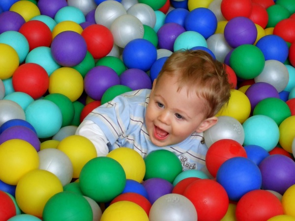 Child playing in a tub of balls